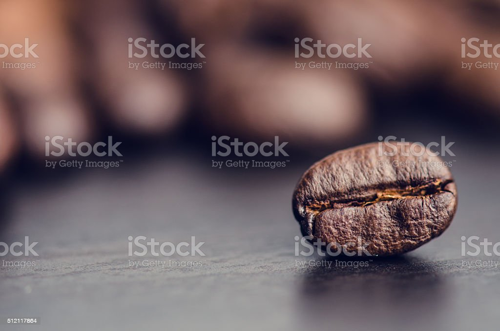 Coffee beans on a black background. Raw coffee beans. stock photo