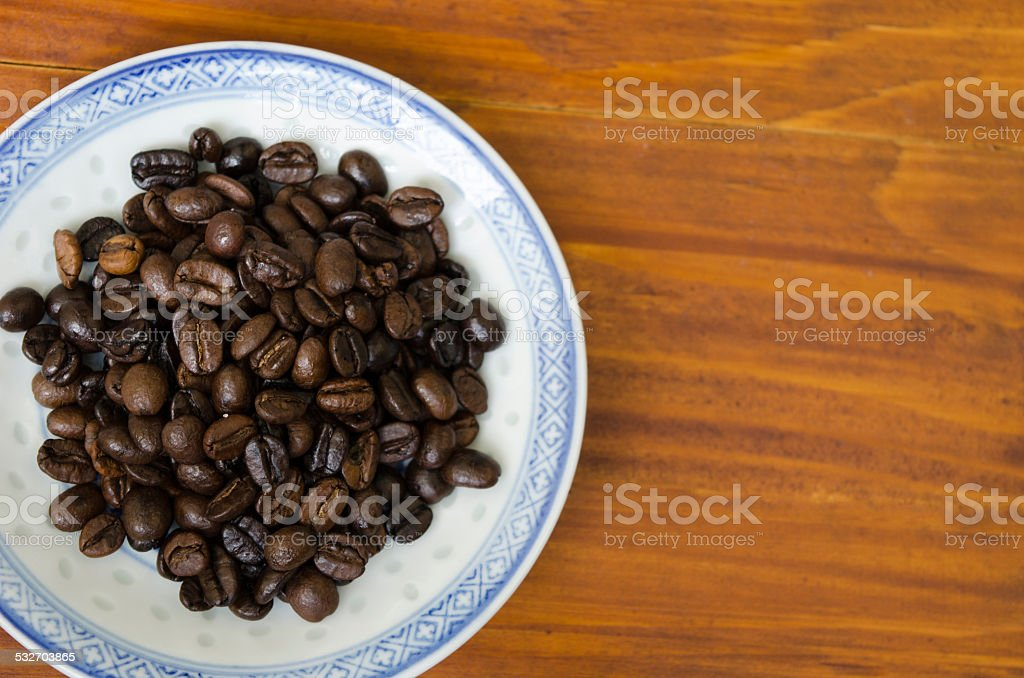 Coffee beans on a plate royalty-free stock photo