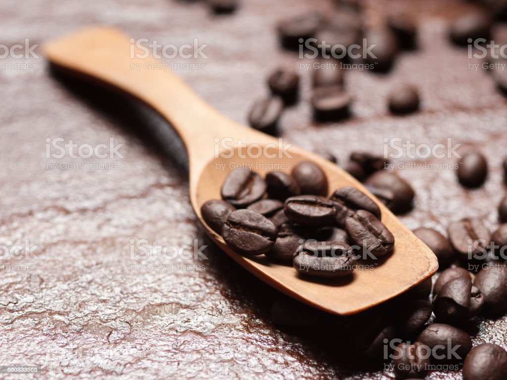 Coffee beans on a stone background. stock photo