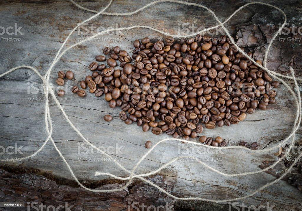 Coffee beans on aged wood stock photo