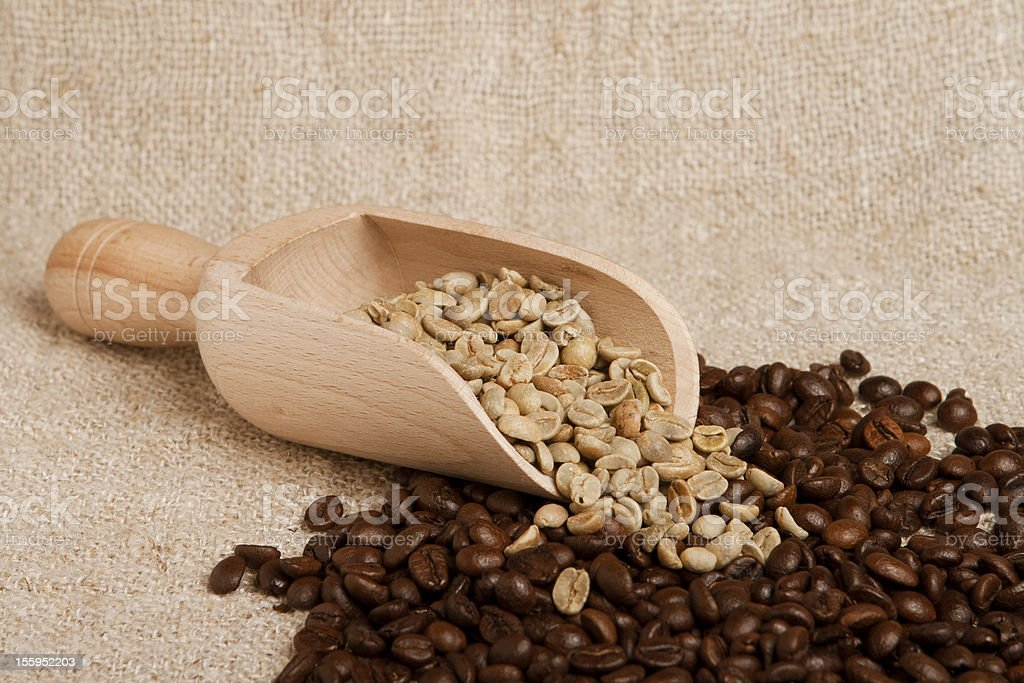 Coffee beans on burlap background. royalty-free stock photo