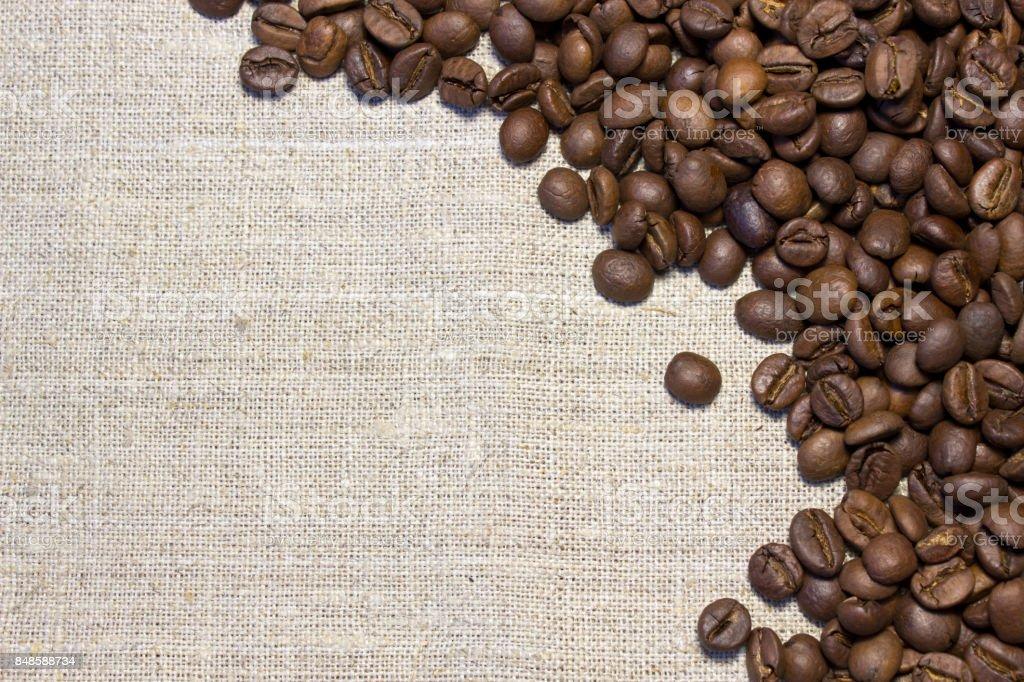 Coffee beans on burlap background stock photo