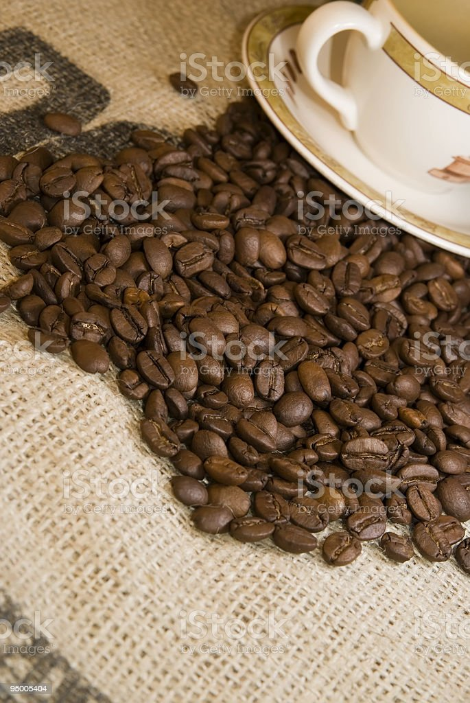coffee beans on burlap bag stock photo