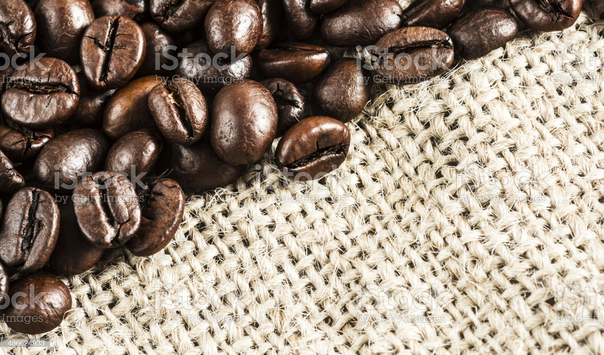 Coffee beans on burlap royalty-free stock photo