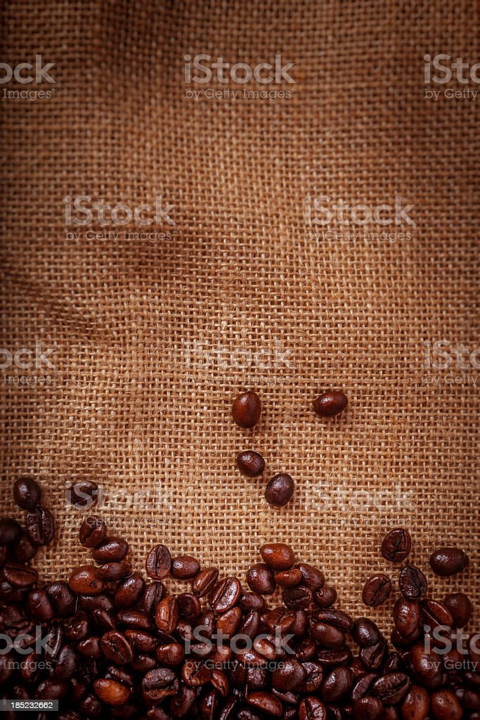 Coffee beans on burlpab background stock photo