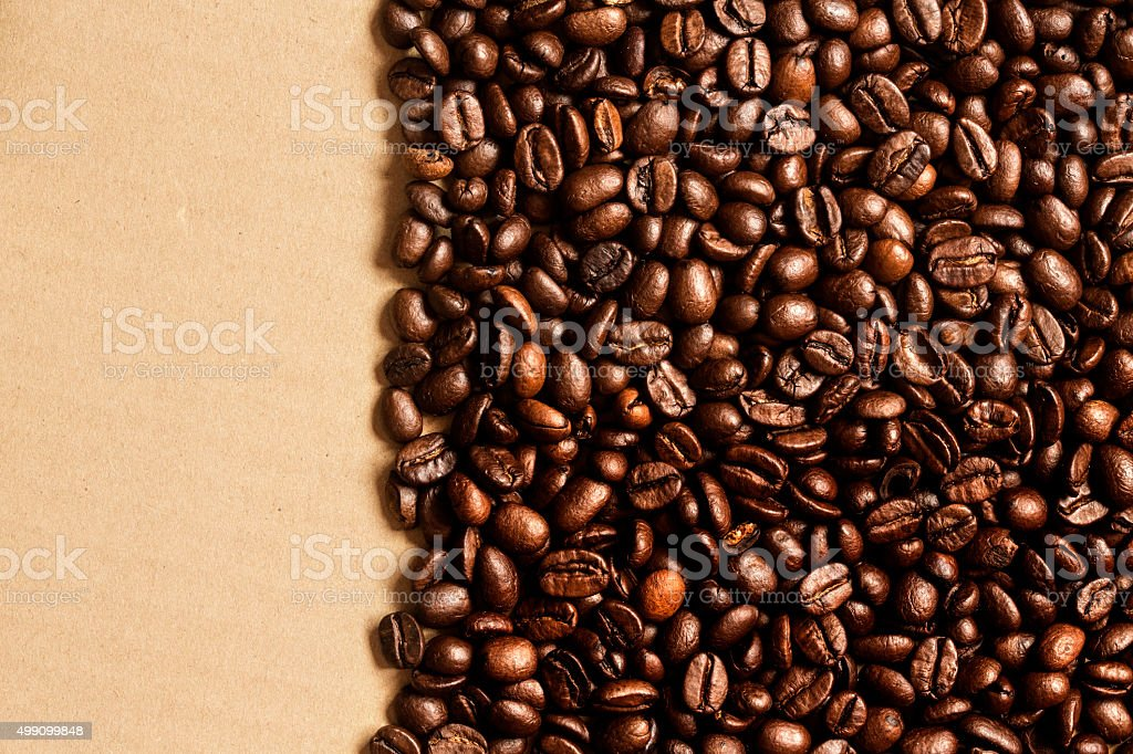 Coffee Beans On Crumpled Paper Background. stock photo