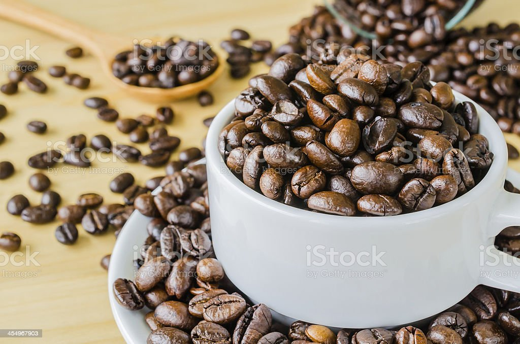 Coffee beans on cup royalty-free stock photo