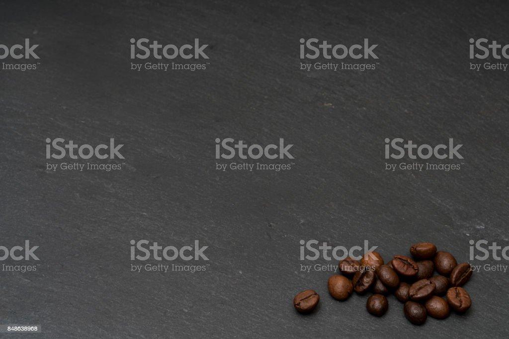 Coffee beans on dark grey slate stock photo