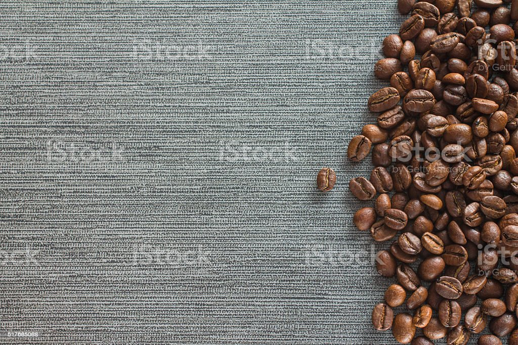Coffee beans on grey tile background stock photo