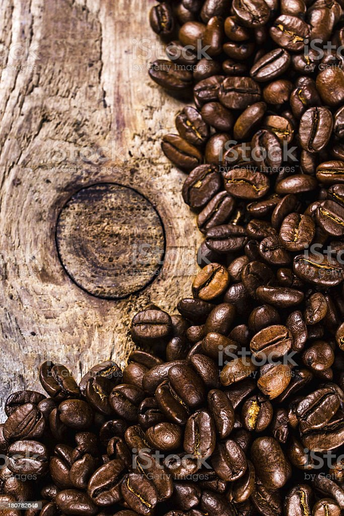 Coffee beans on grunge old wooden background royalty-free stock photo