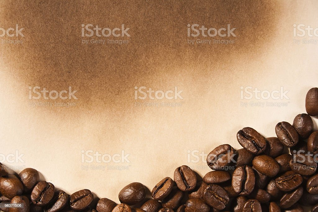 coffee beans on old paper royalty-free stock photo