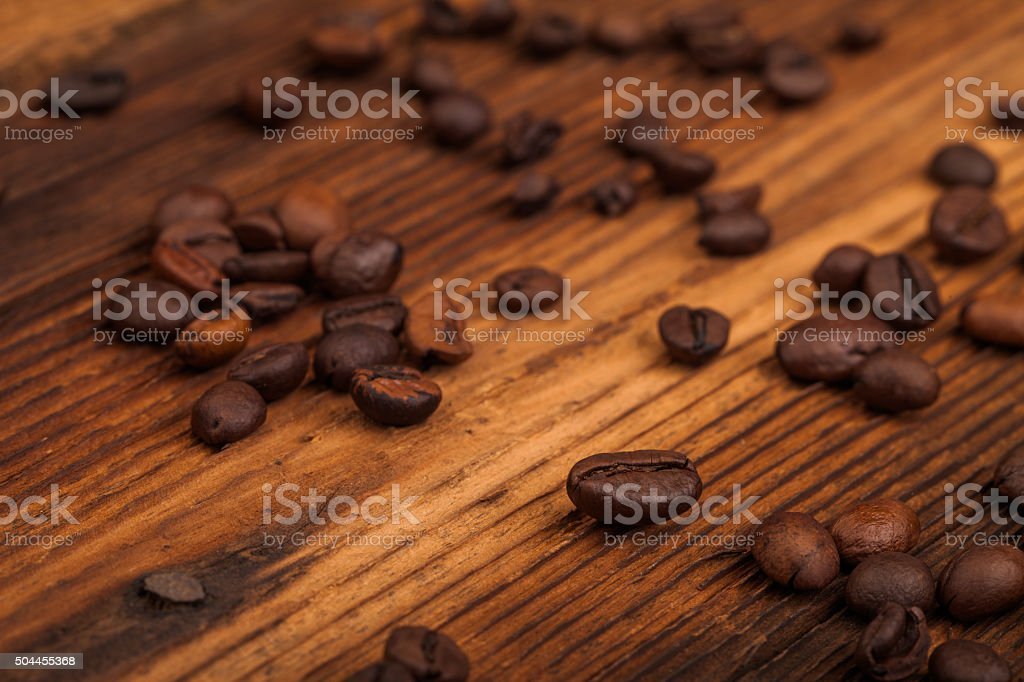coffee beans on old table stock photo