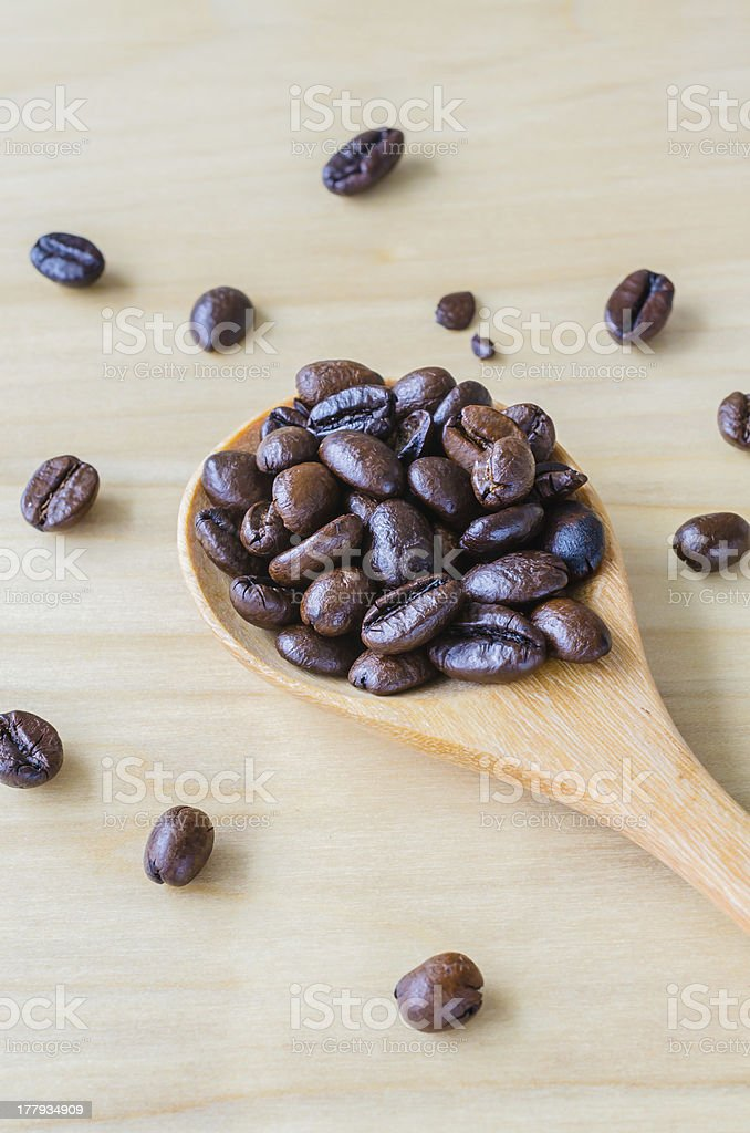 Coffee beans on spoon royalty-free stock photo