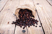 Coffee beans on the wooden background. Hot drinks.