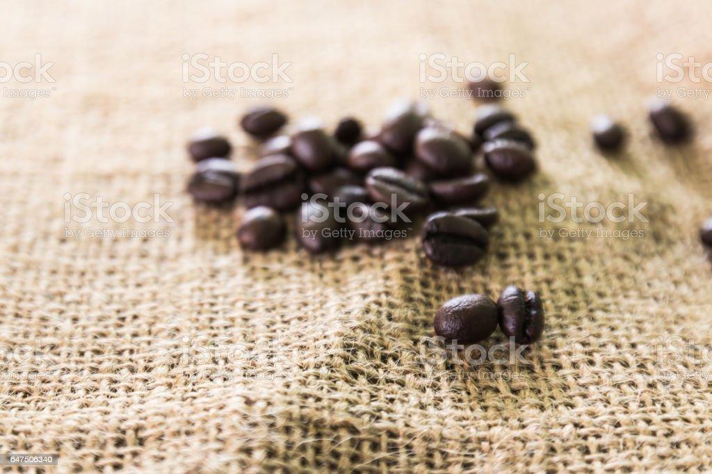 Coffee beans on traditional sack textile stock photo