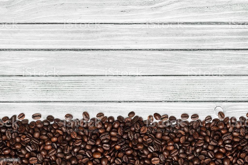 Coffee beans on white table stock photo