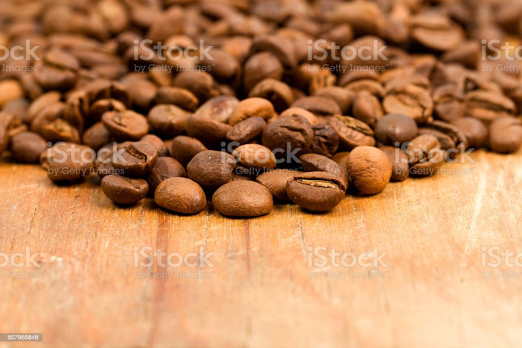 Coffee beans on wood background. stock photo