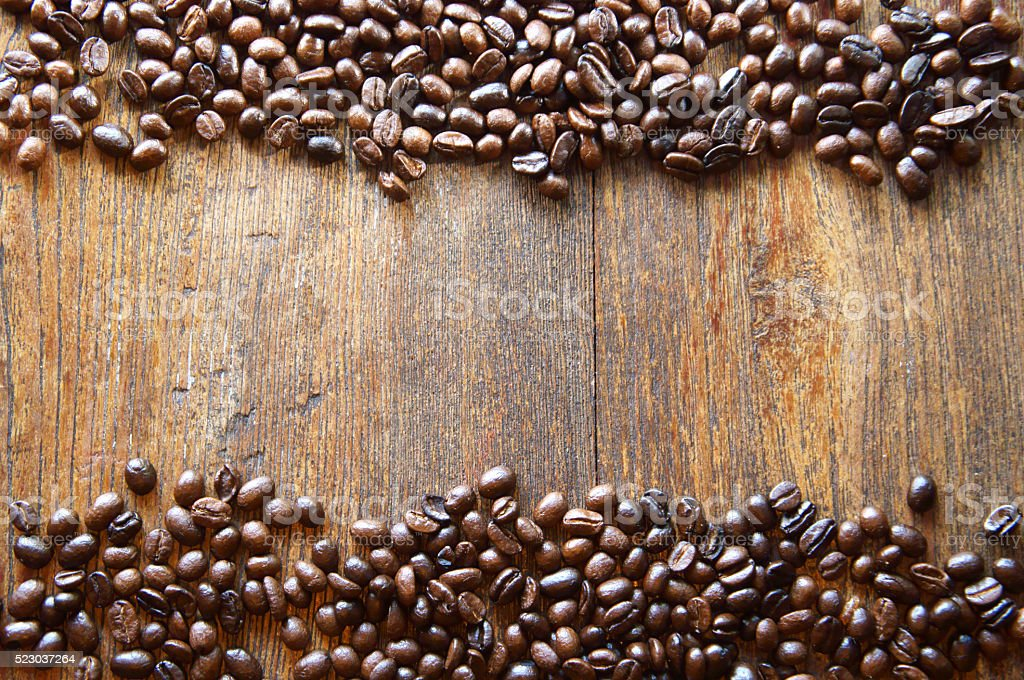 Coffee beans on wood background stock photo