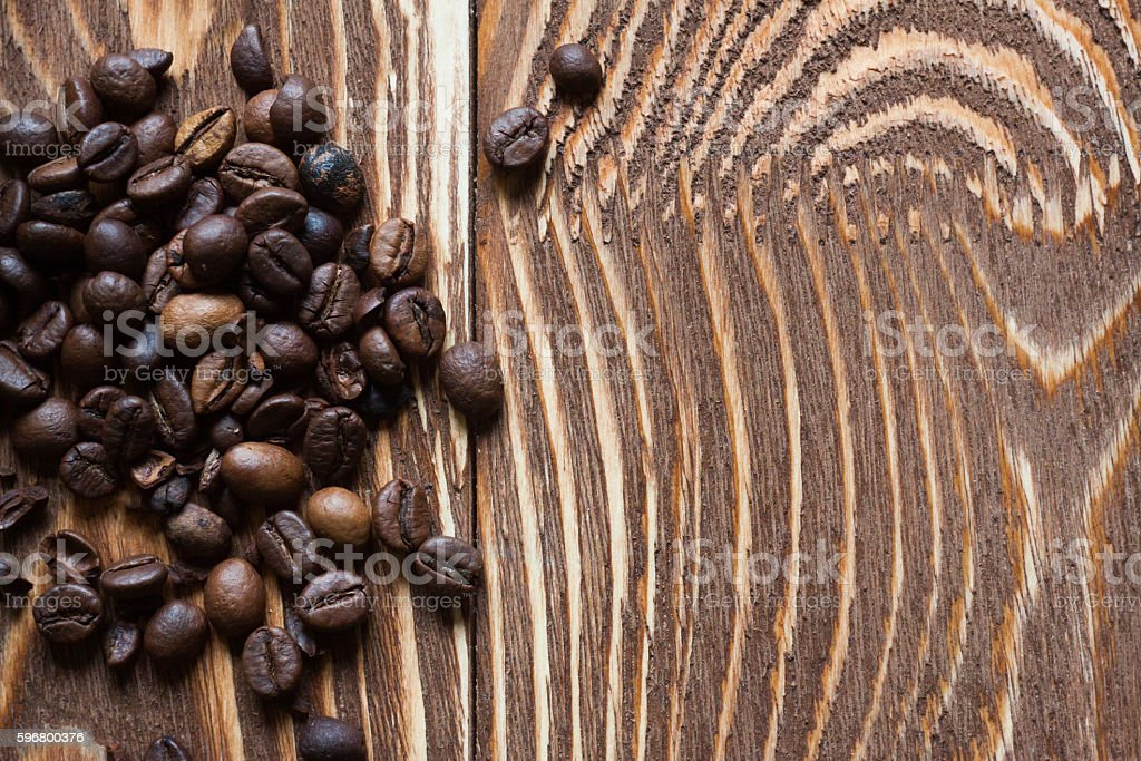 Coffee beans on wood stock photo