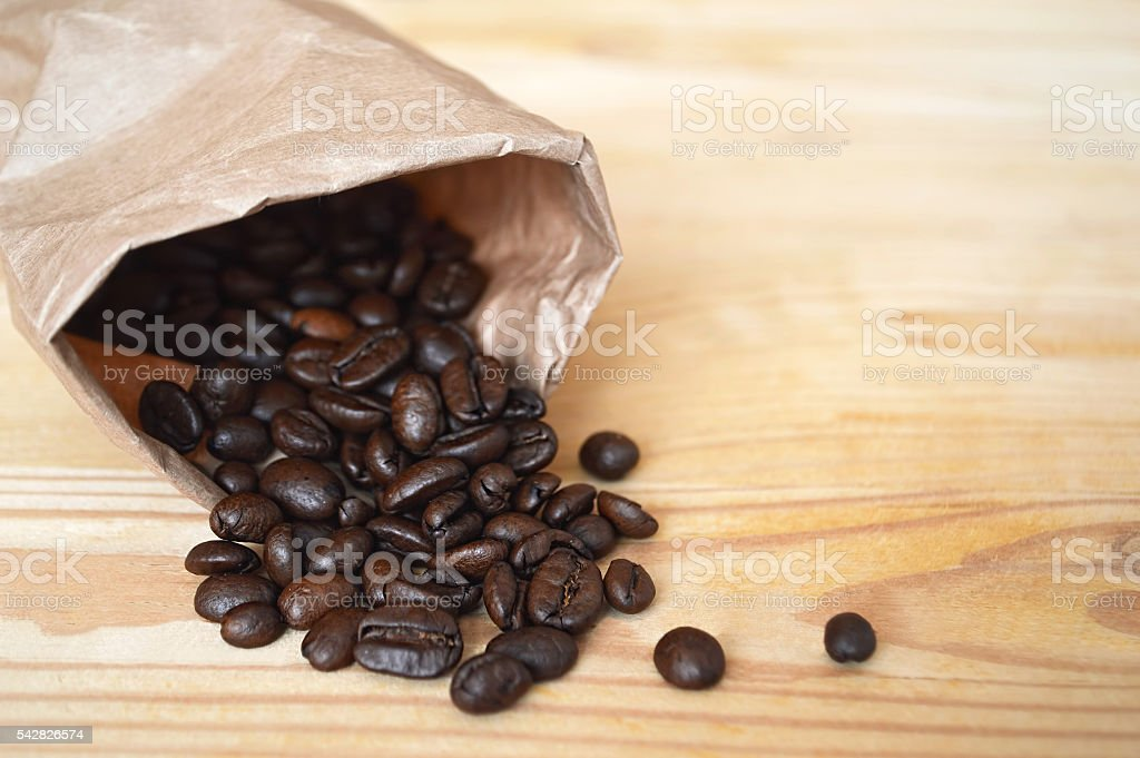 Coffee beans on wooden background stock photo