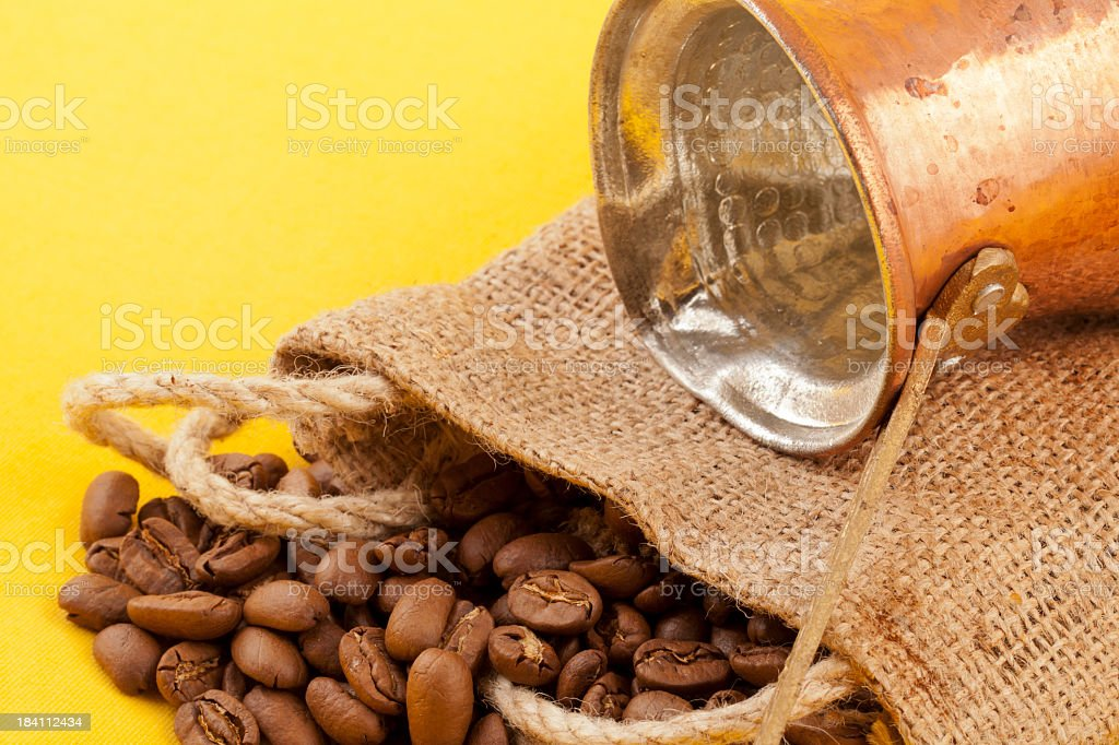 Coffee beans on yellow with coffeepot royalty-free stock photo