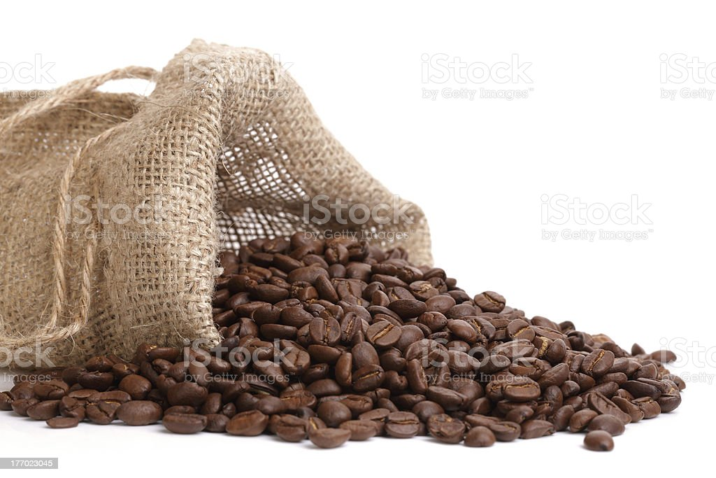 Coffee beans overflowing royalty-free stock photo
