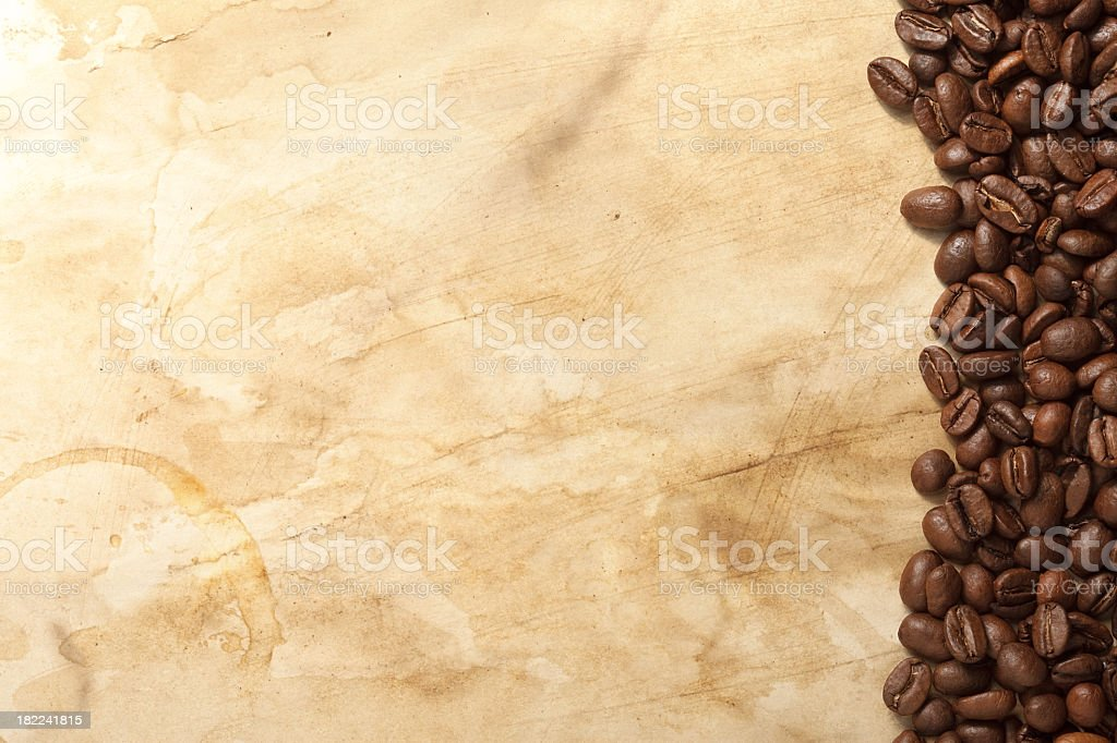 Coffee beans placed on top of a brown surface stock photo