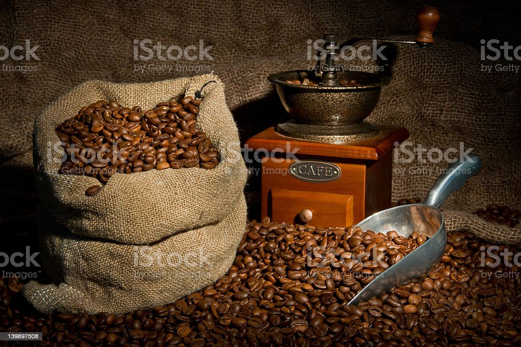 Coffee beans sack, coffee-grinder and metal scoop still life royalty-free stock photo