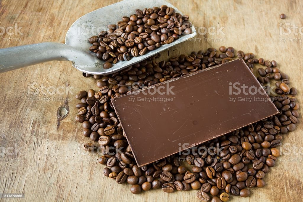Coffee beans shovel  and chocolate bar stock photo