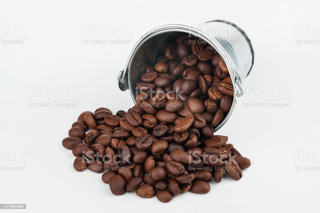 Coffee beans spilling out of bucket stock photo