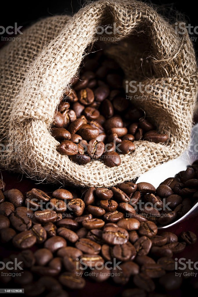 coffee beans spilling royalty-free stock photo