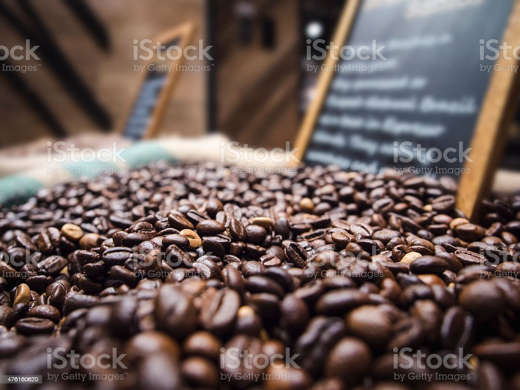 Coffee beans with Chalkboard sign in market stock photo