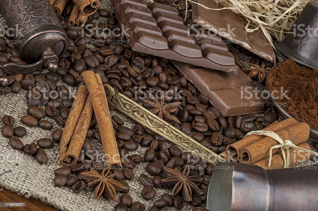 Coffee beans with cinnamon sticks royalty-free stock photo