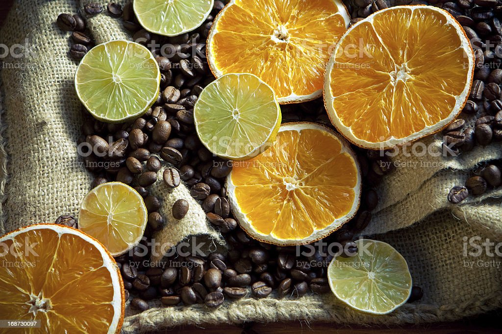 Coffee beans with orange and lemon royalty-free stock photo