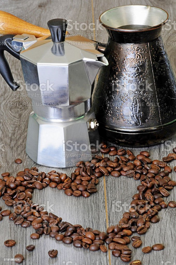 Coffee beans with two coffee machines on gray background stock photo
