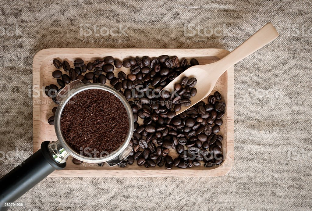coffee beans, wood spoon and coffee maker on the desktop stock photo