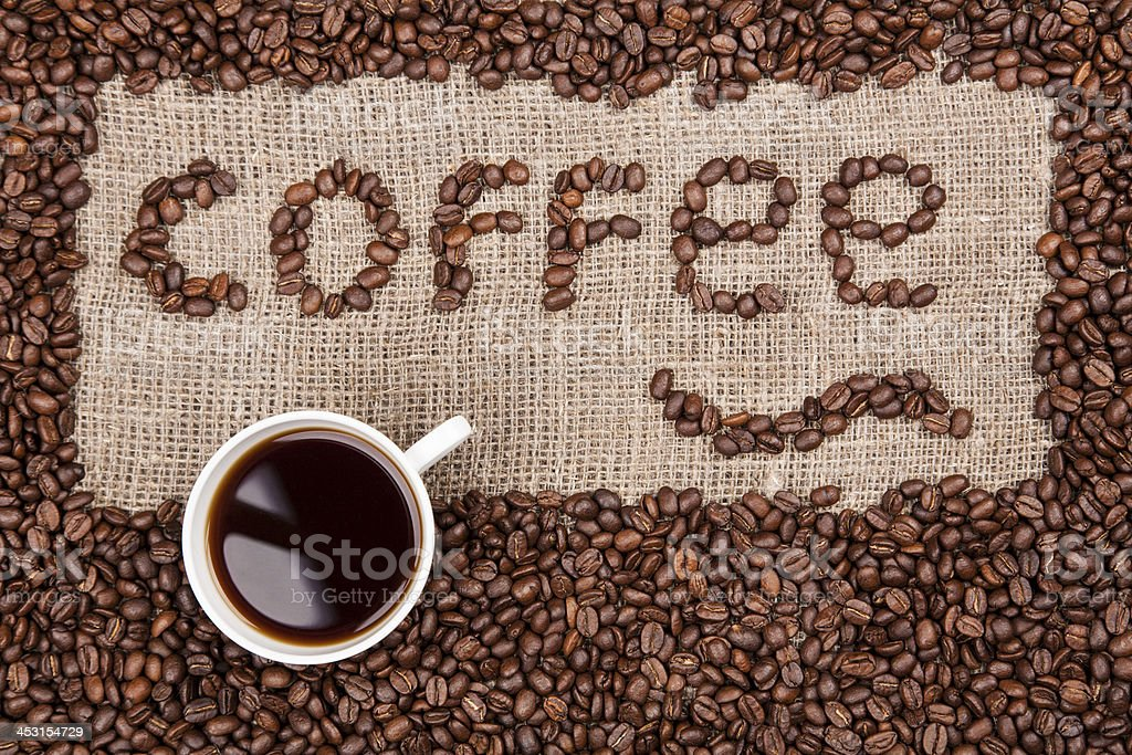 Coffee beans writing on sack cloth royalty-free stock photo
