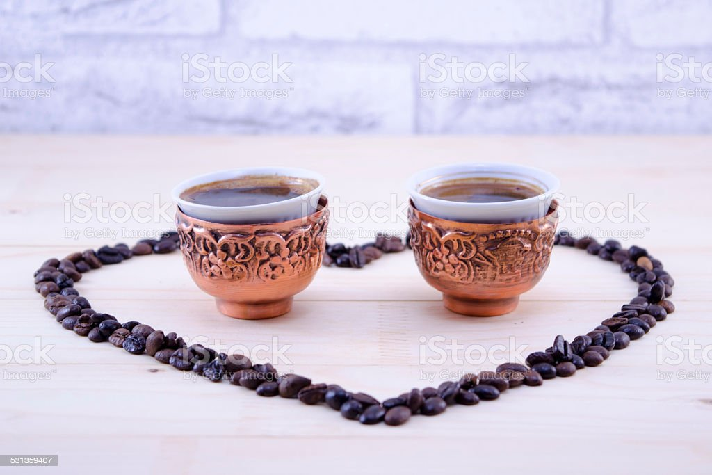 Coffee been shaped heart royalty-free stock photo