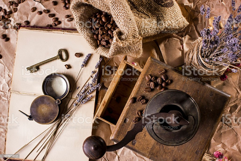 Coffee, book and coffee grinder stock photo