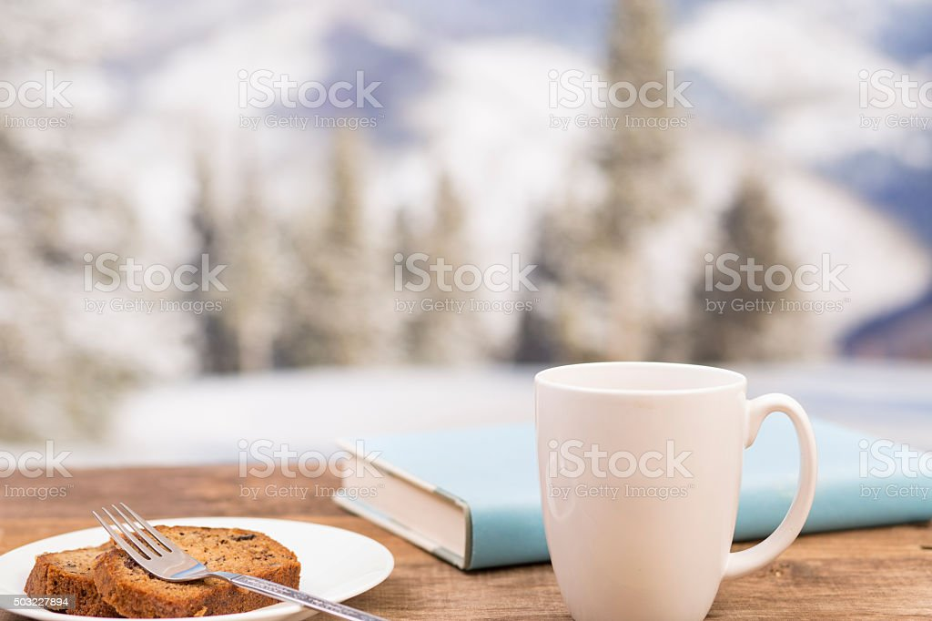 Coffee, book, cake on winter background.  Relaxation. stock photo