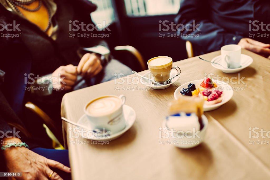 Coffee break between senior friends stock photo