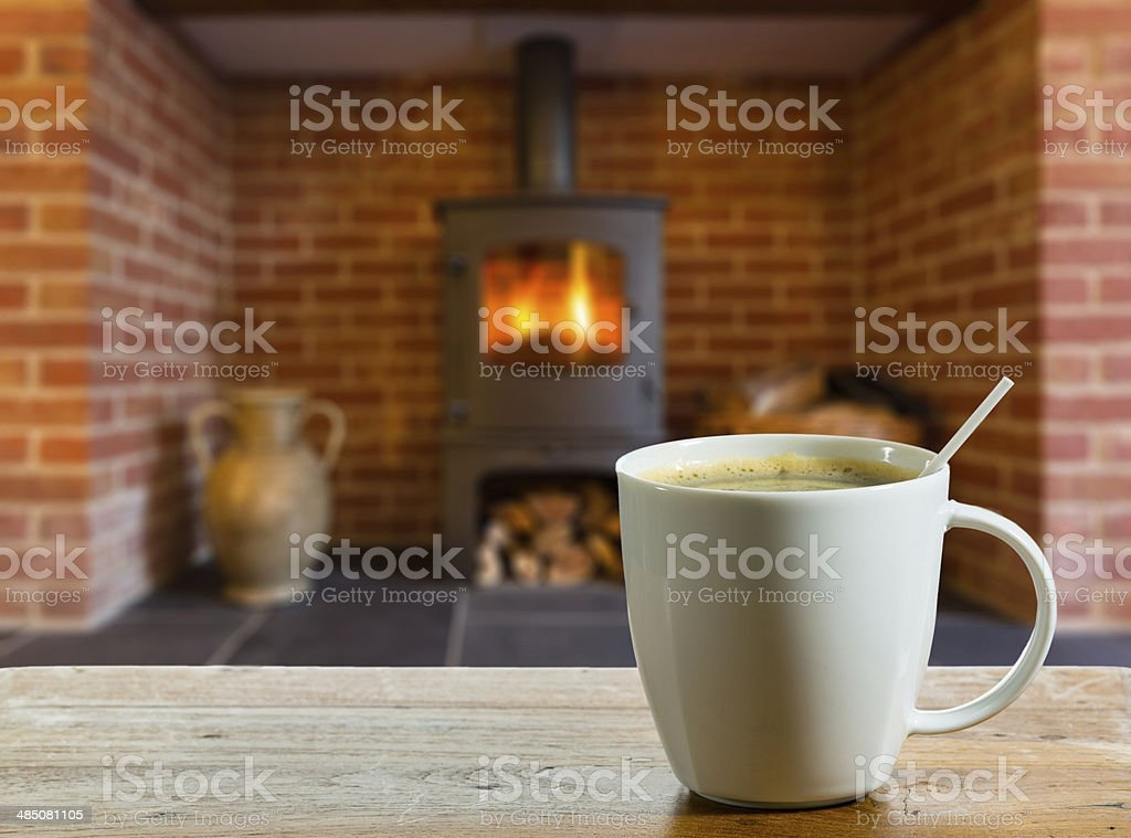 Coffee Break by wood burning fire stock photo