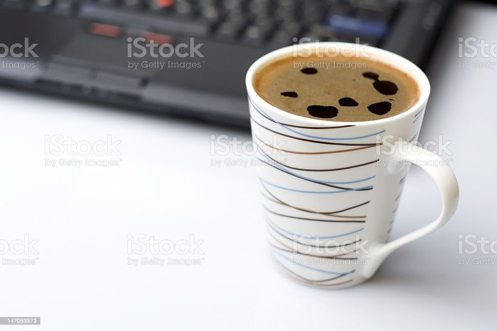 Coffee break  in office and laptop on a desk royalty-free stock photo