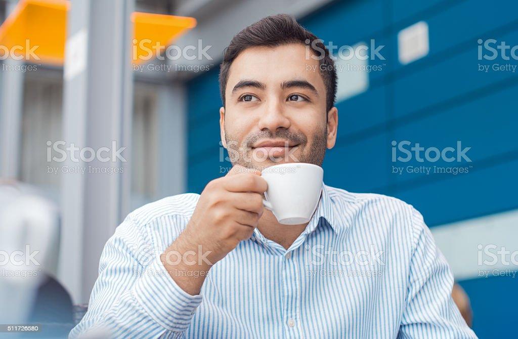 Coffee break, man resting with warmly drink stock photo