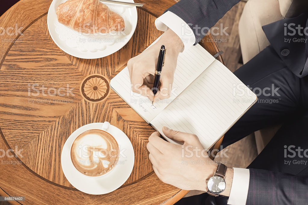 coffee break with a cap of coffee and croisant stock photo