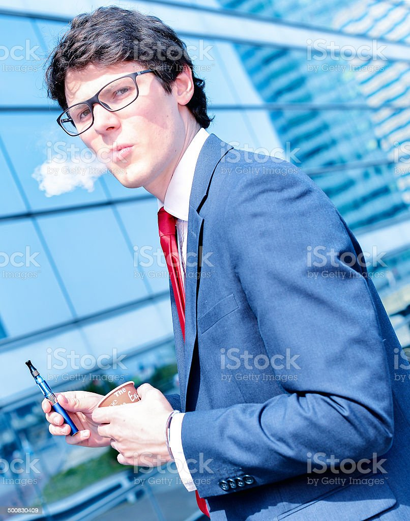 coffee break with an electronic cigarette royalty-free stock photo
