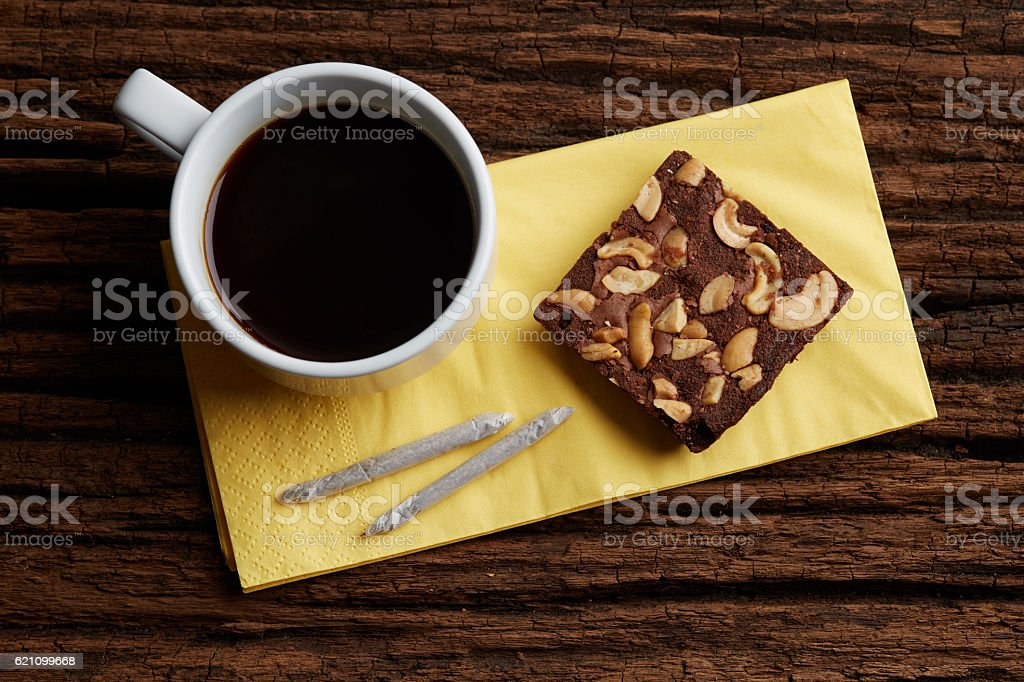 Coffee Break with brownie and marijuana joints set for relax stock photo