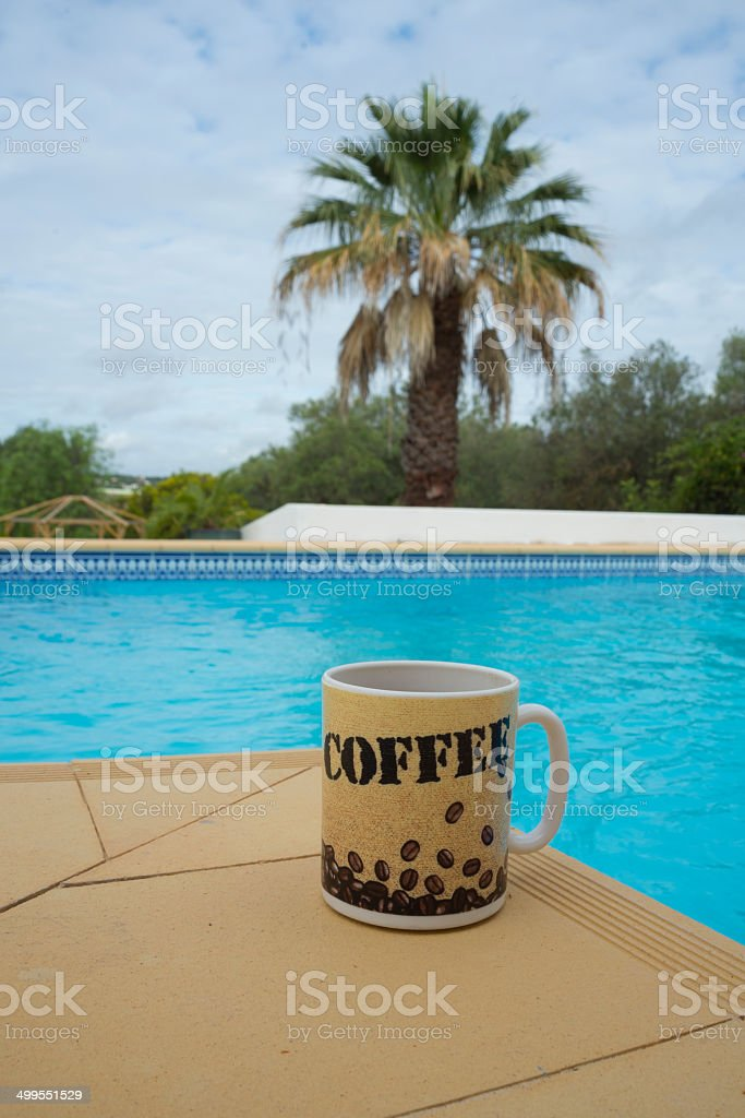 Coffee by the pool royalty-free stock photo
