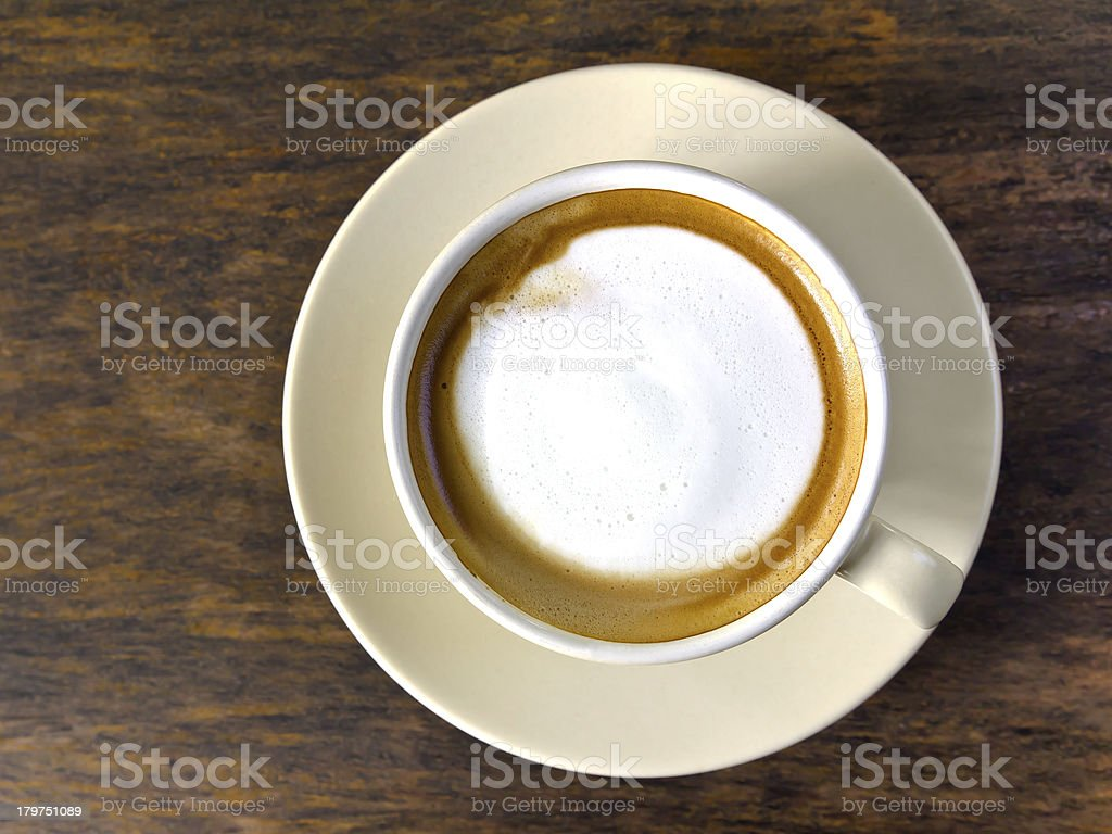 Coffee cappuccino cup on wood table in morning royalty-free stock photo
