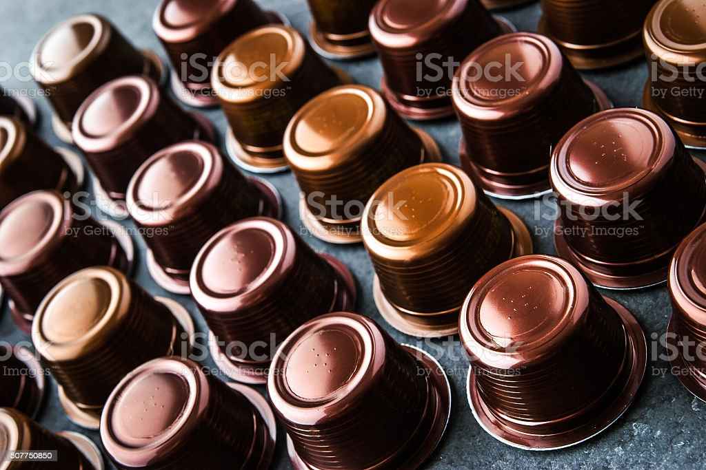 Coffee capsules on the dark table horizontal stock photo